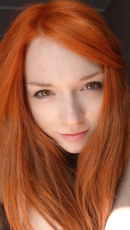stellar woman with crimson hair..