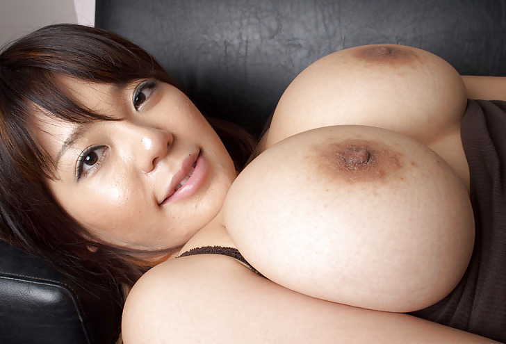 Huge-boobed Asian Model posing..
