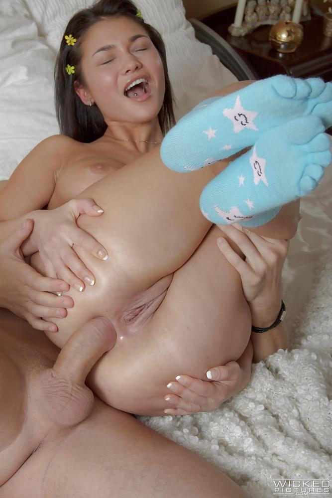 Tiny  Xenia leaves her nice socks on..
