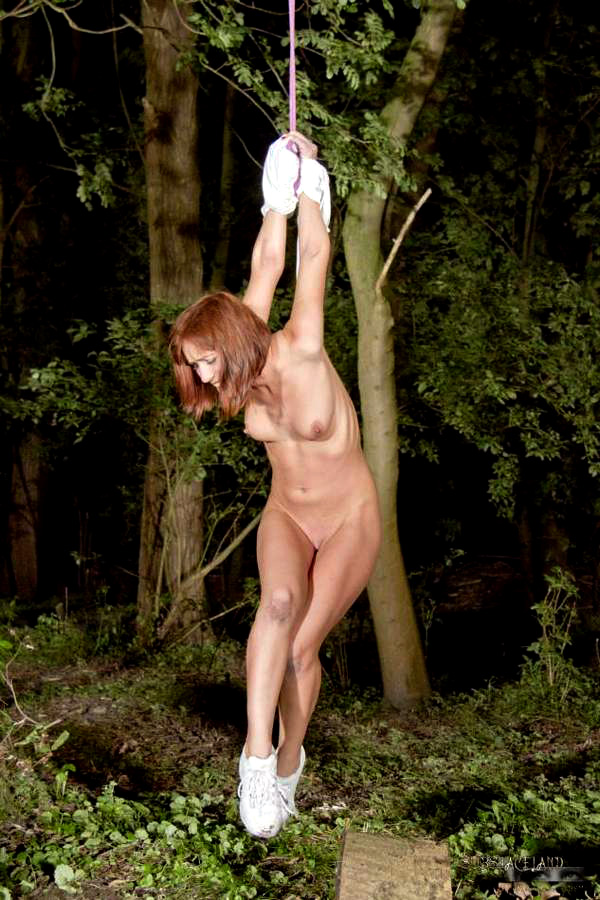 Thin red-haired little girl suffers..
